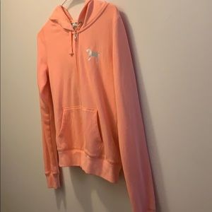 A peach colored PINK hoodie